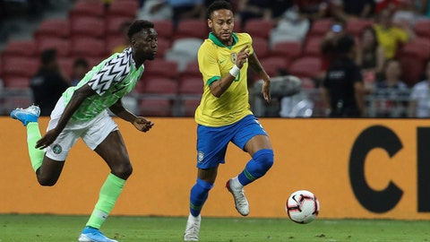 <p>               Brazil's Neymar Jr, right, and Nigeria's Anderson Esiti go for the ball during the international friendly match between Brazil and Nigeria in Singapore, Sunday, Oct. 13, 2019. (AP Photo/Danial Hakim)             </p>