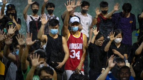 <p>               A demonstrator wearing Houston Rockets jersey holds up his hand with fellow demonstrators during a rally at the Southorn Playground in Hong Kong, Tuesday, Oct. 15, 2019. Protesters in Hong Kong have thrown basketballs at a photo of LeBron James and chanted their anger about comments the Los Angeles Lakers star made about free speech during a rally in support of NBA commissioner Adam Silver and Houston Rockets general manager Daryl Morey, whose tweet in support of the Hong Kong protests touched off a firestorm of controversy in China. (AP Photo/Mark Schiefelbein)             </p>