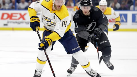 <p>               Nashville Predators defenseman Mattias Ekholm (14) controls the puck in front of Tampa Bay Lightning center Brayden Point (21) during the first period of an NHL hockey game Saturday, Oct. 26, 2019, in Tampa, Fla. (AP Photo/Chris O'Meara)             </p>