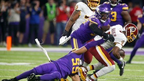 <p>               Washington Redskins quarterback Dwayne Haskins (7) is sacked by Minnesota Vikings defenders Anthony Barr (55) and Everson Griffen (97) during the second half of an NFL football game, Thursday, Oct. 24, 2019, in Minneapolis. (AP Photo/Jim Mone)             </p>