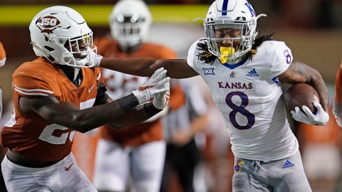 <p>               Kansas' Kwamie Lassiter II (8) tries to run past Texas' B.J. Foster (25) during the second half of an NCAA college football game in Austin, Texas, Saturday, Oct. 19, 2019. (AP Photo/Chuck Burton)             </p>