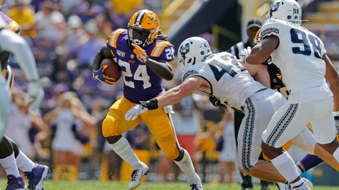 <p>               LSU running back Chris Curry (24) carries against Utah State defensive end Nick Heninger (42) in the second half of an NCAA college football game in Baton Rouge, La., Saturday, Oct. 5, 2019. (AP Photo/Gerald Herbert)             </p>