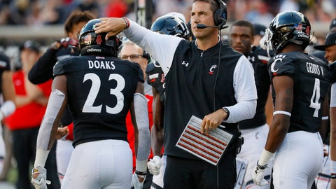 <p>               Cincinnati head coach Luke Fickell, right, congratulates running back Gerrid Doaks (23) after his touchdown during the second half of an NCAA college football game against Tulsa, Saturday, Oct. 19, 2019, in Cincinnati. (AP Photo/John Minchillo)             </p>