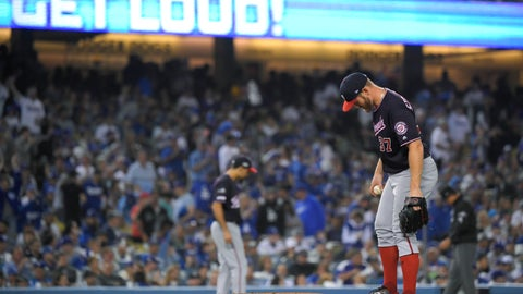 <p>               Washington Nationals starting pitcher Stephen Strasburg kicks the mound after a single by Los Angeles Dodgers' Will Smith that broke up his perfect game during the fifth inning in Game 2 of a baseball National League Division Series on Friday, Oct. 4, 2019, in Los Angeles. (AP Photo/Mark J. Terrill)             </p>