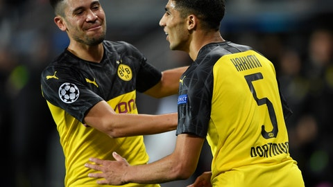 <p>               Borussia Dortmund's Achraf Hakimi, right, celebrates his goal with a teammate Raphael Guerreiro during the Champions League group F soccer match between Slavia Prague and Borussia Dortmund in Prague, Czech Republic, Wednesday, Oct. 2, 2019. (Ondrej Deml/CTK via AP)             </p>