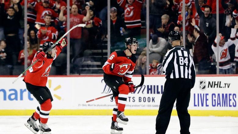 Hughes scores 1st NHL goal in Devils' 1-0 win over Canucks