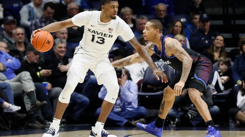 <p>               FILE - This Feb. 9, 2019, file photo shows Xavier's Naji Marshall, left, looking to pass against DePaul's Devin Gage, right, during the second half of an NCAA college basketball game, in Cincinnati. Travis Steele made it through a rough first year as Xavier's coach, losing key players to graduation and injury. The Musketeers return their core players and are ranked No. 19 to start his second season. (AP Photo/John Minchillo, File)             </p>