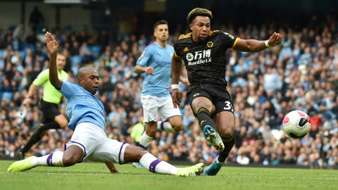 <p>               Wolverhampton Wanderers' Adama Traore, right, scores his second goal during the English Premier League soccer match between Manchester City and Wolverhampton Wanderers at Etihad stadium in Manchester, England, Sunday, Oct. 6, 2019. (AP Photo/Rui Vieira)             </p>