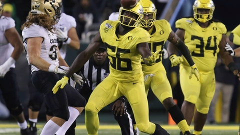 <p>               Oregon's Bryson Young, center, intercepts a tipped pass intended for Colorado's Brady Russell, left, during the third quarter of an NCAA college football game Friday, Oct. 11, 2019, in Eugene, Ore. (AP Photo/Chris Pietsch)             </p>