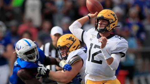 <p>               West Virginia quarterback Austin Kendall (12) passes to a teammate during the first half of an NCAA college football game against Kansas in Lawrence, Kan., Saturday, Sept. 21, 2019. Kendall passed for 202 yards in the game. West Virginia defeated Kansas 29-24. (AP Photo/Orlin Wagner)             </p>