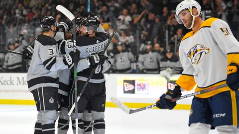 <p>               Los Angeles Kings left wing Kyle Clifford, back right, celebrates his goal with defenseman Matt Roy, left, and another teammate, as Nashville Predators left wing Austin Watson skates by during the second period of an NHL hockey game Saturday, Oct. 12, 2019, in Los Angeles. (AP Photo/Mark J. Terrill)             </p>