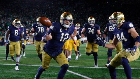 <p>               Notre Dame quarterback Ian Book (12) celebrates his 8-yard touchdown run in the second half of an NCAA college football game against Southern California in South Bend, Ind., Saturday, Oct. 12, 2019. (AP Photo/Paul Sancya)             </p>