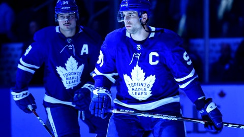 <p>               Toronto Maple Leafs centre John Tavares (91) takes to the ice as team captain prior to the first period of an NHL game, against the Ottawa Senators Wednesday, Oct. 2, 2019 in Toronto. Assistant captain Auston Matthews looks on.(Nathan Denette/The Canadian Press via AP)             </p>