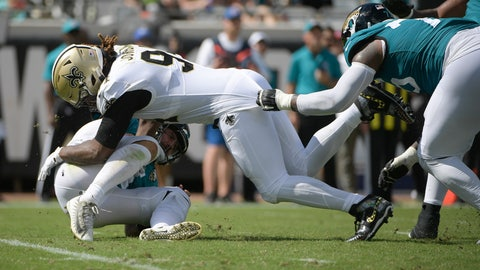 <p>               Jacksonville Jaguars quarterback Gardner Minshew, lower left, is sacked by New Orleans Saints defensive end Cameron Jordan, center, as Jaguars offensive tackle Jawaan Taylor, right, tries to slow Jordan down during the first half of an NFL football game, Sunday, Oct. 13, 2019, in Jacksonville, Fla. (AP Photo/Phelan M. Ebenhack)             </p>