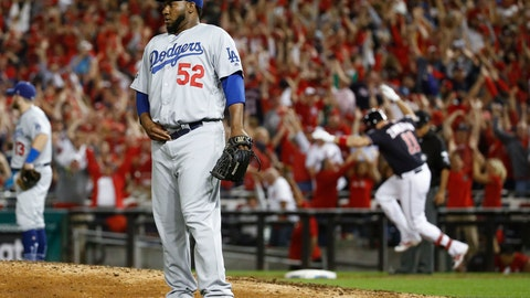 <p>               Los Angeles Dodgers relief pitcher Pedro Baez (52) looks away after giving up a three-run homer to Washington Nationals first baseman Ryan Zimmerman (11) during the fifth inning in Game 4 of a baseball National League Division Series on Monday, Oct. 7, 2019, in Washington. (AP Photo/Patrick Semansky)             </p>