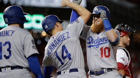 <p>               Los Angeles Dodgers third baseman Justin Turner (10) celebrates his three-run home run off Washington Nationals relief pitcher Wander Suero with teammates Enrique Hernandez (14) and Max Muncy (13) during the sixth inning in Game 3 of a baseball National League Division Series on Sunday, Oct. 6, 2019, in Washington. (AP Photo/Julio Cortez)             </p>