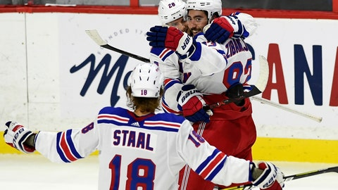 <p>               New York Rangers center Mika Zibanejad (93) celebrates his hat trick with teammates Lias Andersson (28) and Marc Staal (18) during the second period of an NHL hockey game against the Ottawa Senators, Saturday, Oct. 5, 2019 in Ottawa, Ontario. (Justin Tang/The Canadian Press via AP)             </p>