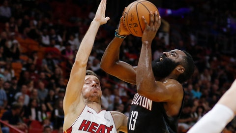 <p>               Houston Rockets guard James Harden (13) shoots next to Miami Heat guard Goran Dragic (7) during the first quarter of an NBA preseason basketball game Friday, Oct. 18, 2019, in Miami. (AP Photo/Joe Skipper)             </p>
