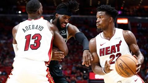 <p>               Miami Heat forward Jimmy Butler (22) dribbles the ball against San Antonio Spurs forward DeMarre Carroll (77) during the second half of an NBA preseason basketball game Tuesday, Oct. 8, 2019, in Miami. (AP Photo/Brynn Anderson)             </p>