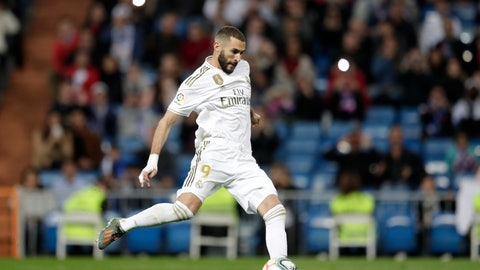 <p>               Real Madrid's Karim Benzema prepares to shoot to score his side's fourth goal from a penalty kick during a Spanish La Liga soccer match between Real Madrid and Leganes at the Santiago Bernabeu stadium in Madrid, Spain, Wednesday, Oct. 30, 2019. (AP Photo/Bernat Armangue)             </p>