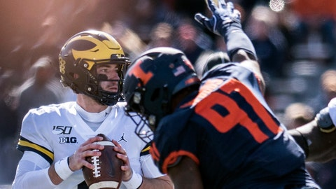 <p>               Michigan quarterback Shea Patterson (2) keeps his eye on a receiver as he is pressured by Illinois' Bobby Roundtree (97) in the second half of an NCAA college football game between Illinois and Michigan, Saturday, Oct. 12, 2019, in Champaign, Ill. (AP Photo/Holly Hart)             </p>