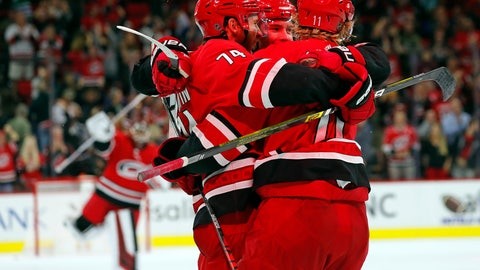 <p>               Carolina Hurricanes' Jaccob Slavin (74) celebrates his winning overtime goal in an NHL hockey game against the Tampa Bay Lightning with teammates Andrei Svechnikov (37) of Russia, and Jordan Staal (11) in Raleigh, N.C., Sunday, Oct. 6, 2019. (AP Photo/Karl B DeBlaker)             </p>