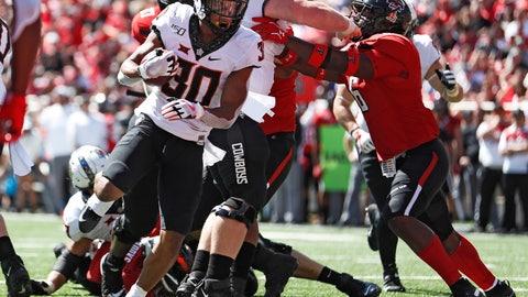 <p>               Oklahoma State's Chuba Hubbard (30) scores a touchdown during the second half of an NCAA college football game against Texas Tech, Saturday, Oct. 5, 2019, in Lubbock, Texas. (AP Photo/Brad Tollefson)             </p>