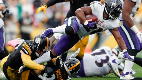 <p>               Baltimore Ravens running back Mark Ingram (21) leaps over Pittsburgh Steelers outside linebacker T.J. Watt (90) on a run in the second half of an NFL football game, Sunday, Oct. 6, 2019, in Pittsburgh. (AP Photo/Don Wright)             </p>