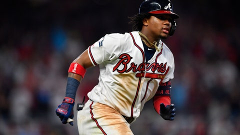 <p>               Atlanta Braves center fielder Ronald Acuna Jr. (13) runs to first base after a hit against the St. Louis Cardinals in the seventh inning during Game 1 of a best-of-five National League Division Series, Thursday, Oct. 3, 2019, in Atlanta. (AP Photo/John Amis)             </p>