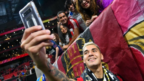 <p>               Atlanta United defender Franco Escobar takes a selfie with fans after round one of an MLS Cup playoff soccer game against the New England Revolution, Saturday, Oct. 19, 2019, in Atlanta. Atlanta won 1-0. (AP Photo/John Amis)             </p>