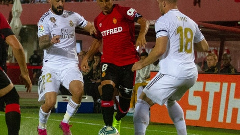 <p>               Real Madrid's Isco, left, Real Madrid's Luka Jovic, right, fight for the ball with Mallorca's Salva Sevilla during the Spanish La Liga soccer match between Mallorca and Real Madrid at the Iberostar Estadi in Palma de Mallorca, Spain, Saturday, Oct. 19, 2019. (AP Photo/Francisco Ubilla)             </p>