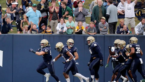<p>               Navy linebacker Diego Fagot, far left, celebrates after returning an interception off a pass from Tulane quarterback Justin McMillan, not visible, for a touchdown during the first half of an NCAA college football game, Saturday, Oct. 26, 2019, in Annapolis. (AP Photo/Julio Cortez)             </p>