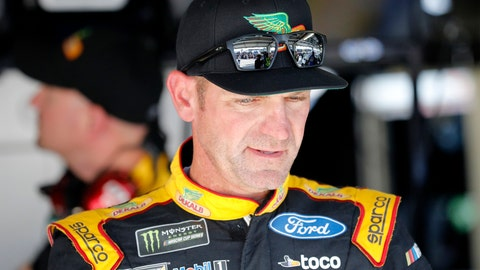 <p>               Clint Bowyer walks from the garage area following practice for a NASCAR Cup Series auto race at Kansas Speedway in Kansas City, Kan., Friday, Oct. 18, 2019. (AP Photo/Colin E. Braley)             </p>