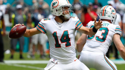 <p>               FILE - In this Sept. 15, 2019, file photo, Miami Dolphins quarterback Ryan Fitzpatrick (14) looks to pass during the first half at an NFL football game against the New England Patriots, in Miami Gardens, Fla. Ryan Fitzpatrick will start at quarterback Sunday for the winless Miami Dolphins at Buffalo, and Josh Rosen will be back on the bench. Coach Brian Flores announced the decision Wednesday, Oct. 16, 2019. (AP Photo/Wilfredo Lee, File)             </p>