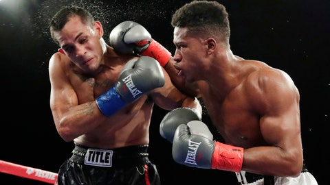 <p>               FILE - In this Oct. 27, 2018, file photo, Patrick Day, right, punches Elvin Ayala during the fifth round of a WBC super welterweight boxing bout in New York. Day won the fight. Day died Wednesday, Oct. 16, 2019, four days after sustaining head injuries in a fight with Charles Conwell. Promoter Lou DiBella said Day died at Northwestern Memorial Hospital. He was 27. (AP Photo/Frank Franklin II, File)             </p>