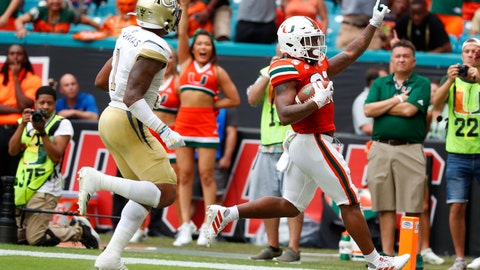 <p>               Miami running back Cam'Ron Harris, right, celebrates as he scores against Georgia Tech defensive back Juanyeh Thomas (1) during the first half of an NCAA college football game, Saturday, Oct. 19, 2019, in Miami Gardens, Fla. (AP Photo/Wilfredo Lee)             </p>