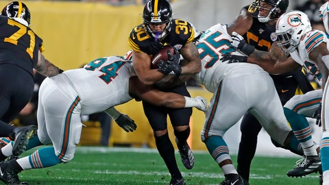 <p>               Pittsburgh Steelers running back James Conner (30) is tackled by Miami Dolphins defensive tackles Christian Wilkins (94) and John Jenkins (95) during the first half of an NFL football game in Pittsburgh, Monday, Oct. 28, 2019. (AP Photo/Keith Srakocic)             </p>