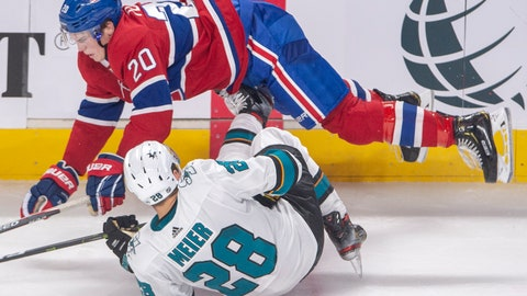 <p>               Montreal Canadiens defenseman Cale Fleury (20) knocks over San Jose Sharks right wing Timo Meier (28) during the third period of an NHL hockey game Thursday, Oct. 24, 2019, in Montreal. (Ryan Remiorz/The Canadian Press via AP)             </p>