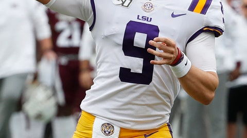 <p>               LSU quarterback Joe Burrow (9) passes for a first down against Mississippi State during the first half of their NCAA college football game in Starkville, Miss., Saturday, Oct. 19, 2019. In addition to LSU winning 36-13, Burrow threw four touchdowns to break the LSU season record with 29. (AP Photo/Rogelio V. Solis)             </p>