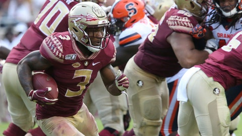 <p>               Florida State's Cam Akers, left, looks for an opening in the Syracuse defense during the fourth quarter of an NCAA college football game, Saturday, Oct. 26, 2019, in Tallahassee Fla. (AP Photo/Steve Cannon)             </p>