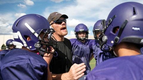 <p>               In this Aug. 7, 2019 photo, then-Miyamura High School Patriots football head coach John Roanhaus huddles with the team in their first week of practice to open the football season in Gallup, N.M. Roanhaus was arrested Saturday, Oct. 5, 2018, after authorities say a student used cell video to catch their coach taking money from a player's wallet. (Alma E. Hernandez/Gallup Independent via AP)             </p>