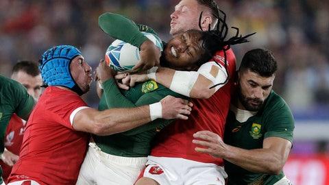 <p>               Wales' Dan Biggar, second right, tackles South Africa's S'Busiso Nkosi during the Rugby World Cup semifinal at International Yokohama Stadium between Wales and South Africa in Yokohama, Japan, Sunday, Oct. 27, 2019. (AP Photo/Mark Baker)             </p>