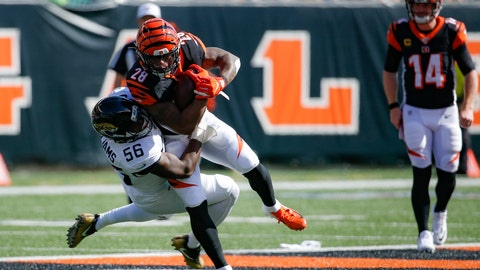 <p>               Cincinnati Bengals running back Joe Mixon (28) is tackled by Jacksonville Jaguars linebacker Quincy Williams (56) in the first half of an NFL football game, Sunday, Oct. 20, 2019, in Cincinnati. (AP Photo/Frank Victores)             </p>