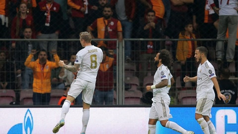 <p>               Real Madrid's Toni Kroos, left, celebrates with teammates after scoring his side's opening goal during the Champions League group A soccer match between Galatasaray and Real Madrid in Istanbul, Tuesday, Oct. 22, 2019. (AP Photo)             </p>