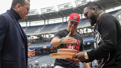 <p>               Alex Rodriguez and David Ortiz give Washington Nationals' Juan Soto a cake for his 21st birthday before Game 3 of the baseball World Series against the Houston Astros Friday, Oct. 25, 2019, in Washington. (AP Photo/Pablo Martinez Monsivais)             </p>