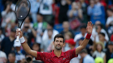 <p>               Novak Djokovic of Serbia celebrates after defeating John Isner of the United States in their men's singles match at the Shanghai Masters tennis tournament at Qizhong Forest Sports City Tennis Center in Shanghai, China, Thursday, Oct. 10, 2019. (AP Photo/Andy Wong)             </p>