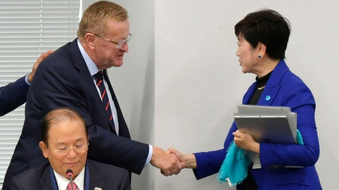 """<p>               FILE - In this Wednesday, Oct. 30, 2019, file photo, Tokyo Gov. Yuriko Koike, right, shakes hands with International Olympic Committee member John Coates during their meeting in Tokyo. The IOC abruptly announced two weeks ago it was moving next year's Olympic marathon from Tokyo to the northern city of Sapporo. Coates, who supervises Tokyo preparations, said the decision was made based on """"what we saw in Doha, Qatar."""" (Kyodo News via AP)             </p>"""
