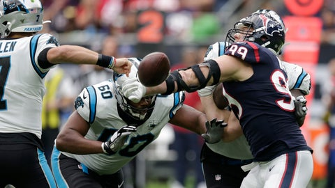 <p>               Houston Texans defensive end J.J. Watt (99) knocks the ball away from Carolina Panthers quarterback Kyle Allen (7) during the second half of an NFL football game Sunday, Sept. 29, 2019, in Houston. Watt recovered the fumble. (AP Photo/Michael Wyke)             </p>