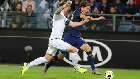 <p>               Wolfsberger's Michael Sollbauer, left, challenges for the ball with Roma's Nicolo Zaniolo during the Europa League group J soccer match between Wolfsberger AC and Roma, in Graz, Austria, Thursday, Oct. 3, 2019. (AP Photo/Ronald Zak)             </p>