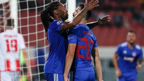 <p>               Olympiakos' Ruben Semedo, left, celebrates with Yassine Meriah after scoring his side's first goal during the Champions League group B soccer match between Red Star and Olympiacos, in Belgrade, Serbia, Tuesday, Oct.1, 2019. (AP Photo/Darko Vojinovic)             </p>